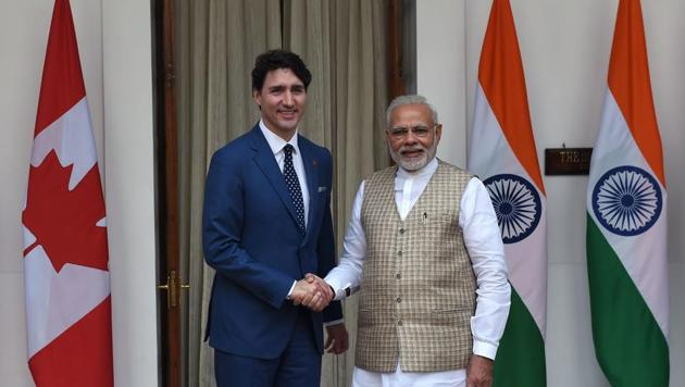 Canadian Prime Minister Justin Trudeau (left) and Indian Prime Minister Narendra Modi shake hands before a meeting at Hyderabad house in New Delhi on February 23(AFP File)