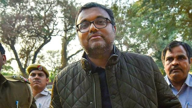 Karti Chidambaram, son of former union minister P Chidambaram escorted by police personnel to the Patiala House court in New Delhi.(PTI File Photo)