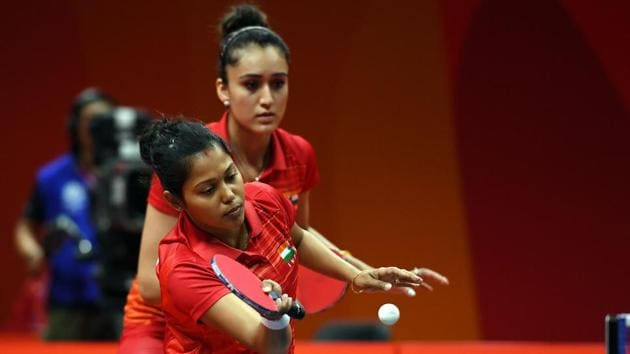 Mouma Das and Manika Batra lost the gold medal match to Tianwei Feng and Yu Mengyu of Singapore in three straight games.(AFP)