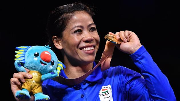 India's Mary Kom poses with her gold medal after beating Northern Ireland's Kristina O'Hara in their women's 45-48kg final boxing match during the 2018 Gold Coast Commonwealth Games at the Oxenford Studios venue on the Gold Coast on April 14, 2018.(AFP)
