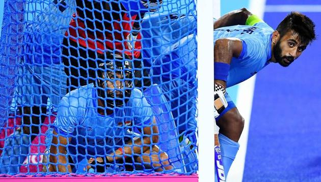 Indian men's hockey team skipper Manpreet Singh (R) gets ready to defend against a penalty corner by England during their hockey bronze medal play-off match of the 2018 Commonwealth Games in Gold Coast on Saturday. England scored twice from penalty corners to win 2-1 and take home the bronze.(AFP)