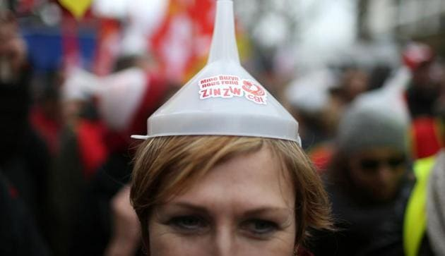 A protester attends a demonstration during a national day of strike against reforms in Paris, France, March 22(REUTERS)