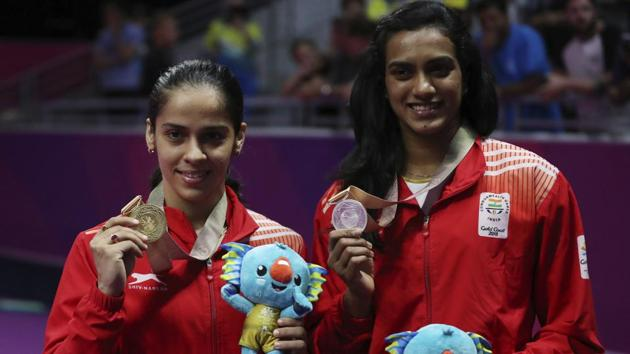 India's Saina Nehwal (L) and PV Sindhu after the women's singles badminton final at Carrara Sports Hall during the 2018 Commonwealth Games on the Gold Coast, Australia on April 15, 2018.(AP)