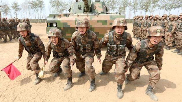 Soldiers of China's People's Liberation Army (PLA) are seen during a military promotional event in Baoding, Hebei province, China March 30.(REUTERS FILE)
