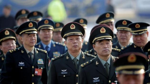 Military delegates from the Chinese People's Liberation Army (PLA) walk toward the Great Hall of the People for a meeting during the annual session of China's parliament, the National People's Congress (NPC), in Beijing, March 4, 2017.(Reuters)