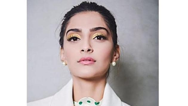 Actor Sonam Kapoor's standout 3D leather belt lends her all-white pantsuit an eye-catching, feminine touch. Scroll through to see. (Instagram)