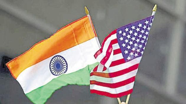 A man holds the flags of India and the U.S. while people take part in the 35th India Day Parade in New York August 16, 2015.(REUTERS File Photo)