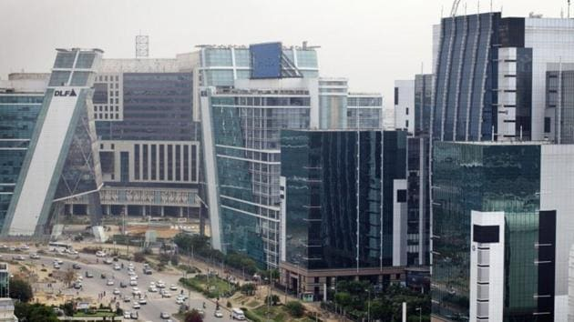 Traffic passes DLF Cybercity, a 128 acre integrated business district, in Gurgaon, India.(Kuni Takahashi/Bloomberg)