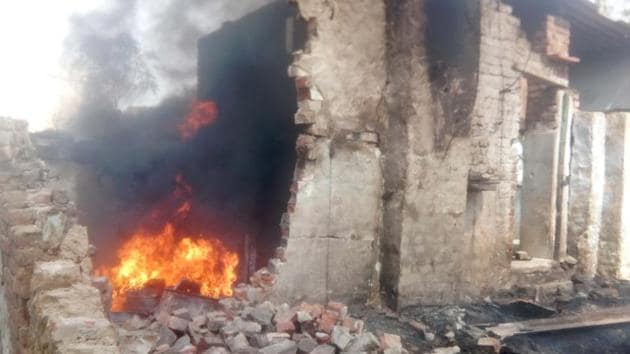 The illegal petrol store that caught fire in Bharatpur on Friday.(HT Photo)