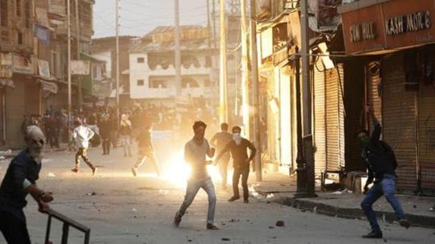 Kashmiri students throw stones towards policemen during a protest in Srinagar.(AP File Photo)
