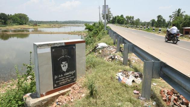 CP Yogeshwar's followers put up a plaque beside the lake at Kodambhalli, in Ramnagara, crediting him with rejuvenating it.(Arijit Sen/Hindustan Times)