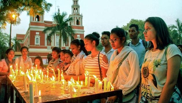 People at a candlelight vigil to protest against the Kathua and Unnao rape cases in New Delhi, on April 18.(PTI)