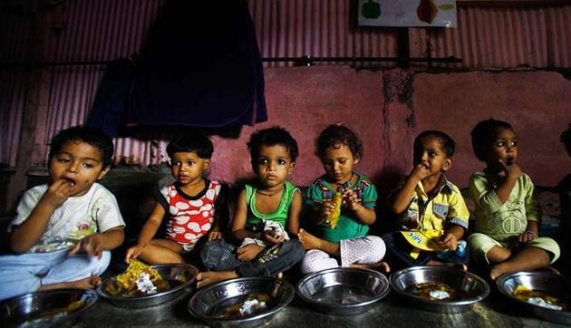 Malnourished children eat at Apanalaya, Mumbai, an organisation working for the betterment of slum children.(AP)