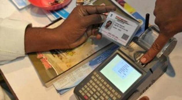 A visitor gives a thumb impression to withdraw money from his bank account with his Aadhaar or Unique Identification (UID) card during a Digi Dhan Mela.(AFP File Photo)