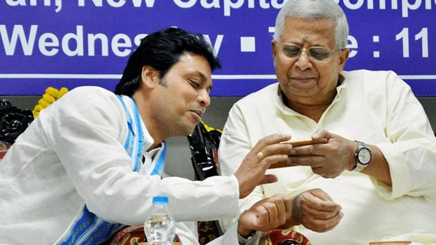 Tripura governor Tathagata Roy and chief minister Biplab Kumar Deb at the inauguration of the new Raj Bhawan building in Agartala on Wednesday. Governor Roy had said it was impossible to think of something such as a cellphone in the 1960's.(PTI)