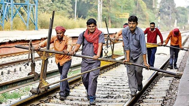 More than 18 million people have applied for 62,907 Group D positions, including those of track maintainers (top), and 4.75 million applications have been received for 26,500 Automotive Loco Pilot posts.(Vipin Kumar/HT File)
