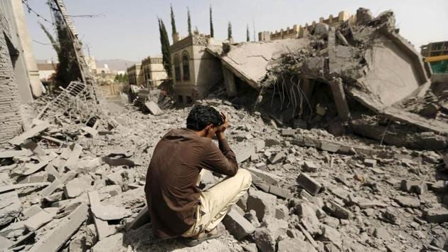 A guard sits on what is left of the house of Brigadier Fouad al-Emad, army commander loyal to the Houthis, after Saudi-led air strikes destroyed it in Sanaa.(Reuters File Photo)