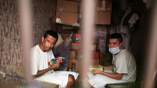 <p>Members of the Torre Fuerte (Strong Tower) church work inside a quarantine cell at the San Francisco Gotera prison, El Salvador. Brutal &lsquo;mara&rsquo;...