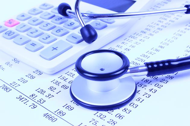 Stethoscope with financial statement(Getty Images/iStockphoto)