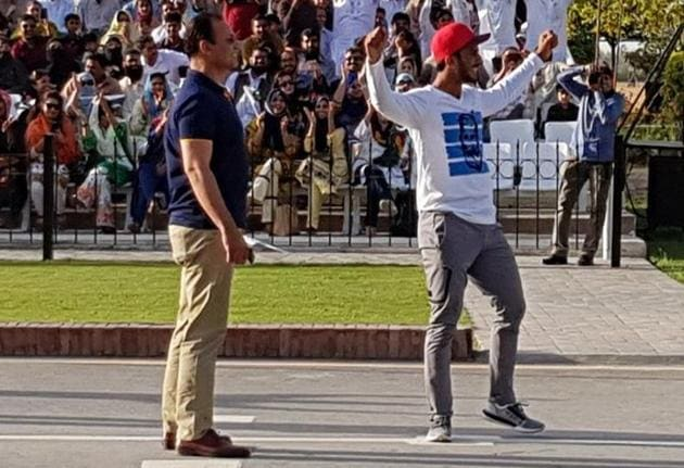 Pakistan cricketer Hasan Ali was seen showing off his trademark wicket celebration during the flag-lowering ceremony at the Wagah border on Saturday, which infuriated India's Border Security Force officials.(Twitter/TheRealPCB)