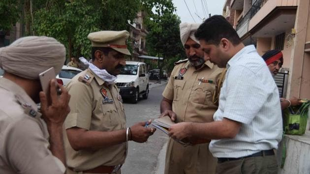Police officials outside the residence of deceased Jaspinder Kaur in Mohali on Saturday.(HT Photo)