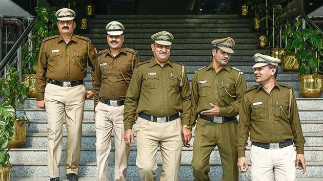 (Left to right) Assistant sub-inspectors Bhagwan Singh, Krishan Kumar Yadav, Naresh Rana, Rajesh Kumar and Jagat Singh at Delhi police headquarters.(Burhaan Kinu/HT Photo)
