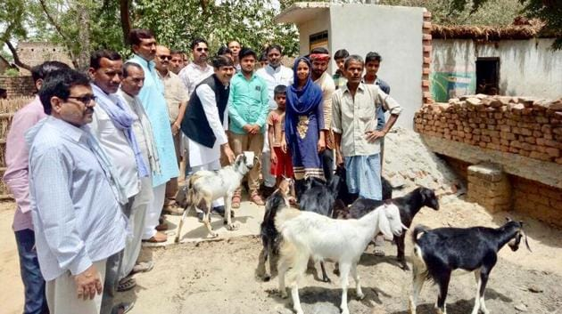 Jabbar Shah (in blue lungi), who on average used to earn about Rs 100 to Rs 150 per day, sold his goats though they were an integral part of his livelihood.(HT Photo)