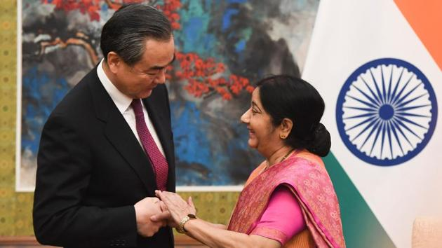 External affairs minister Sushma Swaraj shakes hands with China's foreign minister Wang Yi at the Diaoyutai State Guest House in Beijing on Sunday.(AFP Photo)