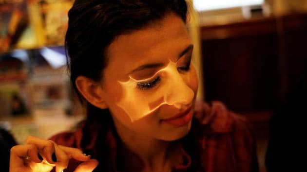 <p>Keilane, 24, who is visually impaired and has 20% vision, applies false eyelashes during a cosmetics class at the Laramara association in Sao Paulo, Brazil....
