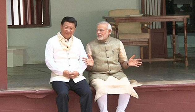 Xi Jinping and Prime Minister Narendra Modi share a quiet moment at the Sabarmati Ashram in Ahmedabad during the Chinese president's India visit.(AFP file Photo)