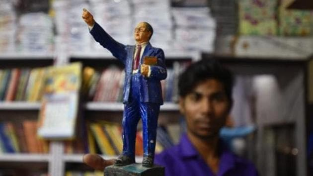 A man sells Bhimrao Ambedkar's merchandise online. Reservation is not a curse upon the country. This privilege of pedigree has to go.(Raj K Raj/HT PHOTO)