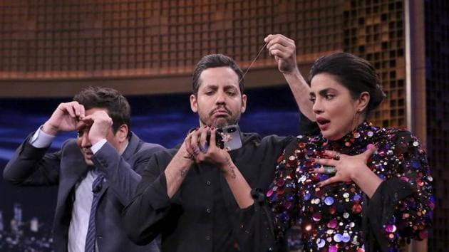 Jimmy Fallon and Priyanka Chopra were more than awestruck by David Blaine's tricks.(Twitter)