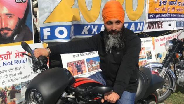 Hardeep Singh Nijjar, wanted in India for targeted killings in Punjab, poses on a motorcycle in front of the Sikhs For Justice float at the nagar kirtan in Surrey last weekend.(Courtesy: Sikhs For Justice)