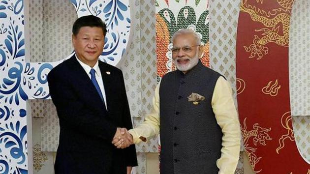Prime Minister Narendra Modi welcomes Chinese President Xi Jinping for the BRICS Summit in Benaulim, Goa.(PTI File Photo)