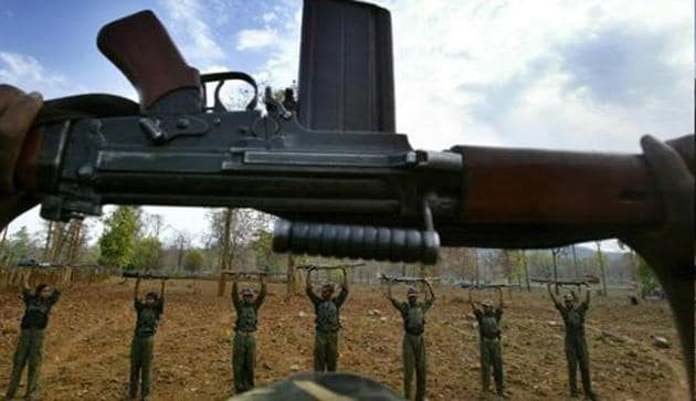 Maoist rebels raise their arms during an exercise at a temporary base in the Abujh Marh forests, in Chhattisgarh.(AP File Photo/Representative image)