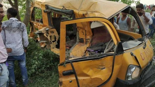 <p>At least 13 school children were killed and several others injured when a train hit a van carrying 20 children at an unmanned level crossing near Dudhi...