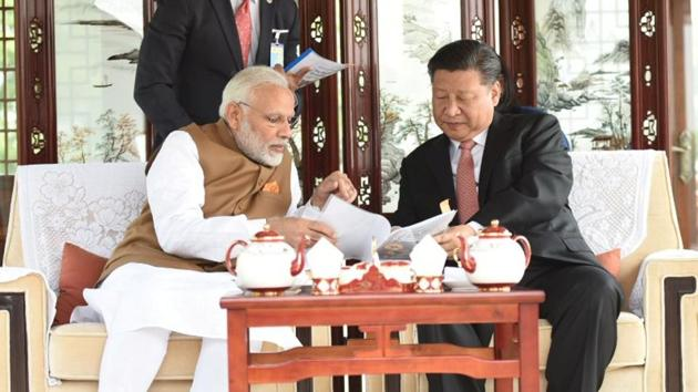 PM Narendra Modi and China president Xi Jinping hold talks while taking a boat ride on Wuhan's East Lake, in China on Saturday.(PIB)