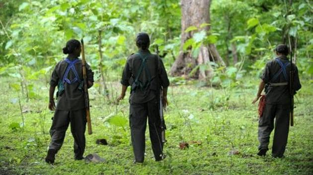 In this file photo taken on July 6, 2012, Maoists patrol their village in Bijapur district in Chhattisgarh.(AFP)