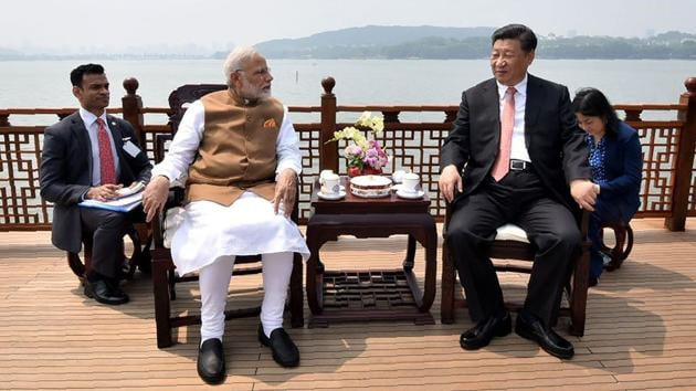 India's Prime Minister Narendra Modi and Chinese President Xi Jinping looking on in a house boat, at East Lake, in Wuhan on April 28.(AFP Photo)