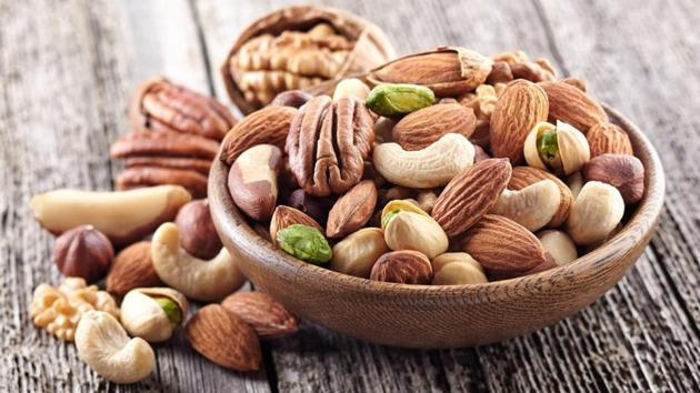 Daily consumption of 45 grammes of almonds in any form (crushed, wholesome, or in snacks) can reduce cholesterol.(Shutterstock)