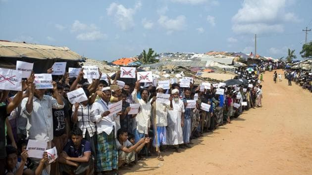 Rohingya refugees holing placards, await the arrival of a UN Security Council team at the Kutupalong Rohingya refugee camp in Kutupalong, Bangladesh on April 29.(AP Photo)