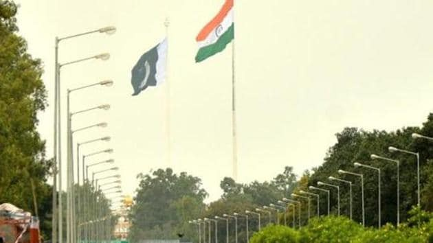 National flags of India and Pakistan on both sides of Indo-Pakistan International Border at Wagha near Amritsar.(HT Photo)