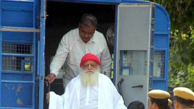 Asaram, accused of sexually assaulting a minor, being taken to a district session court in Jodhpur. If the higher courts don't provide him relief, he'll have to spend the rest of his life behind bars.(Ramji Vyas/Hindustan Times)
