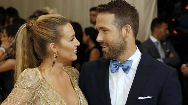 Blake Lively and Ryan Reynolds at an event.