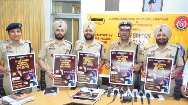 (From left) DCP Amrik Singh Powar; Amritsar police commissioner SS Srivastava; ADCP City2, Lakhbir Singh; ADCP City1, Jagjit Singh Walia and ACP Licensing for Amritsar City, Parvinder Kaur, releasing a poster of Punjabi sufi singer Satinder Sartaj's event in the city on Monday.)(Sameer Sehgal/HT)