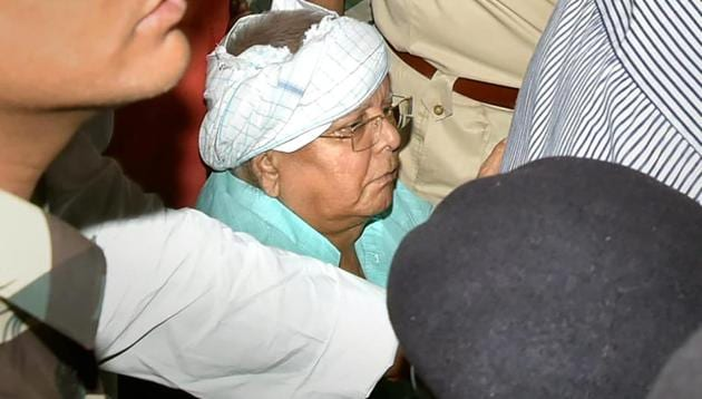 RJD chief and former Bihar chief minister Lalu Prasad Yadav arrives at Ranchi railway station on Tuesday amid heavy security.(PTI)