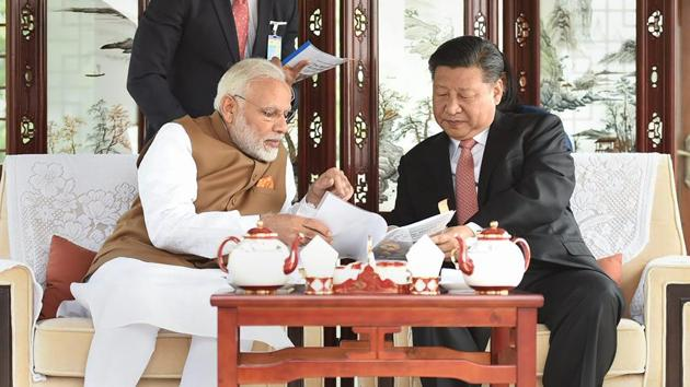 Prime Minister Narendra Modi with Chinese President Xi Jinping inside a house boat, Wuhan's East Lake, China, April 28(PTI)