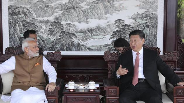Prime Minister Narendra Modi, left, and Chinese President Xi Jinping talk during a meeting in Wuhan in central China's Hubei Province, Saturday, April 28, 2018.(AP Photo)
