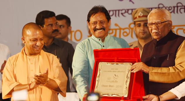 Chief Minister Yogi Adityanath with sports minister Chetan Chauhan and Governor Ram Naik at the event in Lucknow.(Subhankar Chakraborty/HT Photo)