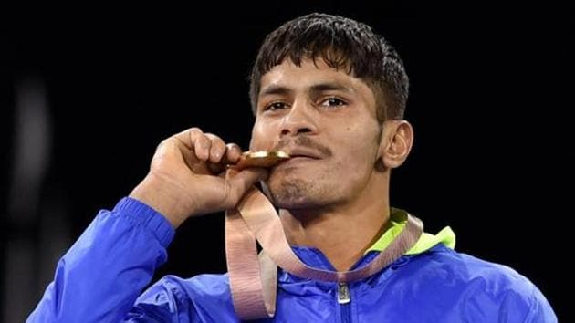 Gold medallist India's Rahul Aware during the medal ceremony of men's freestyle 57kg wrestling final at the Commonwealth Games 2018 in Gold Coast, on Thursday.(PTI File Photo)